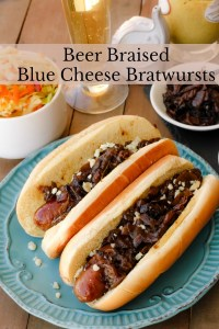 Beer Braised Blue Cheese Bratwursts ~ Blue Cheese Stuffed Bratwursts braised in beer topped with caramelized onions and blue cheese crumbles ~ The Complete Savorist by Michelle De La Cerda