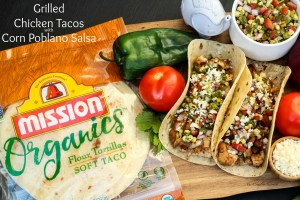 No more boring chicken recipes with these Grilled Chicken Tacos with Corn Poblano Salsa using budget-friendly thighs and garden fresh salsa ingredients ~ The Complete Savorist by Michelle De La Cerda