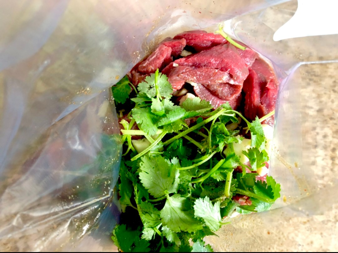 The marinade or mojo for Chipotle London Broil with garlic and cilantro