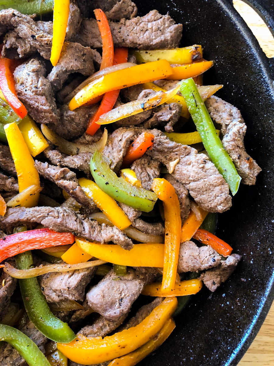 Onions and bell peppers mixed with the meat for Chipotle London Broil Fajitas
