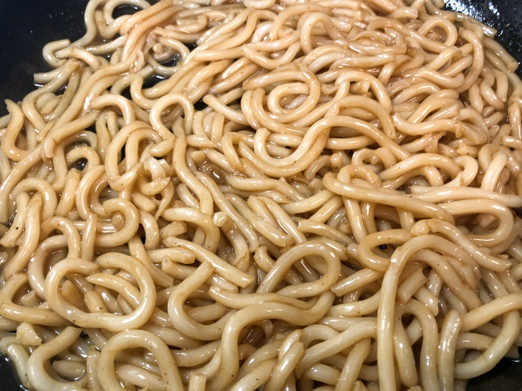 Quickly sautéed the udon noodles in a bit of sesame oil and the reserved broth.
