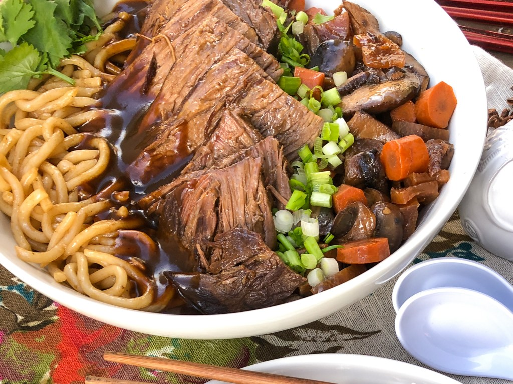 Family style bowl of Japanese style pot roast with udon noodles, vegetables and gravy.