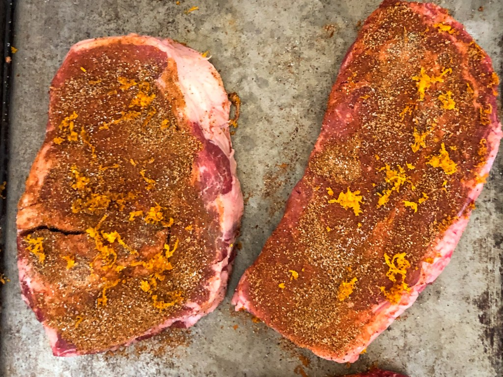 Ribeye steaks rubbed with a Moroccan spice rub including orange zest.