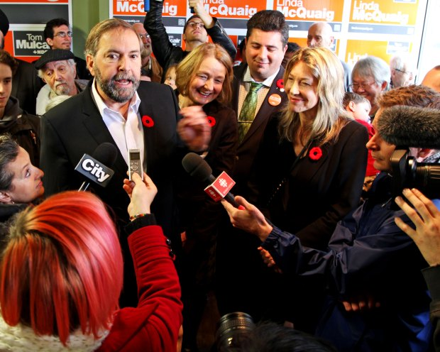 Tom Mulcair and Linda McQuaig speak to reporters in Toronto, November 2013. Photo by Joseph Morris on Flickr.
