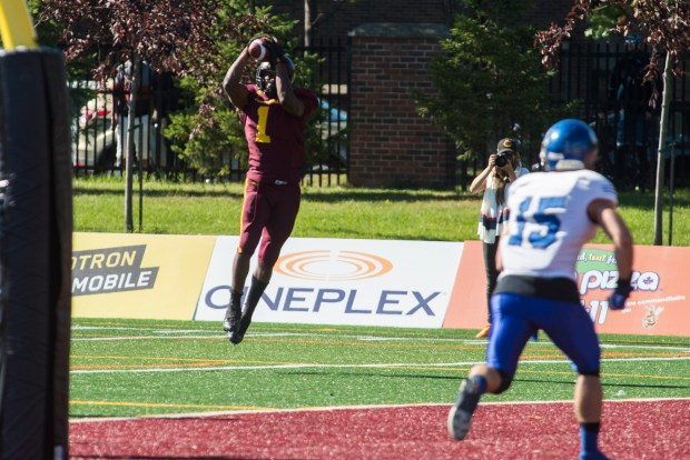 Concordia Running Back Jean-Guy Rimpel making the reception. Photo by Andrej Ivanov.