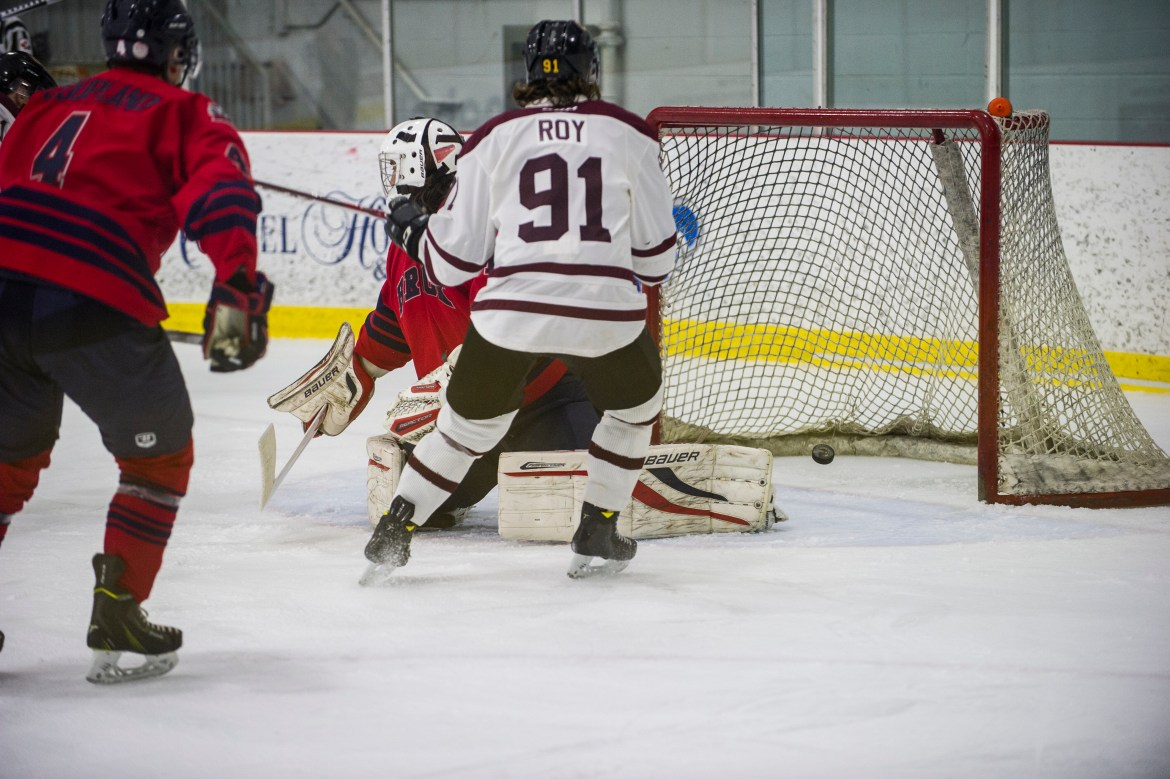 Frederic Roy of the Stingers tips in his goal during the team's win against Brock. Photo by Andrej Ivanov.