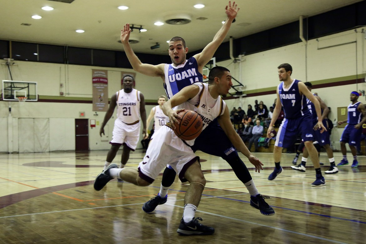 Ricardo Monge goes up against a UQÀM defender during their win. Photo by Brianna Thicke.