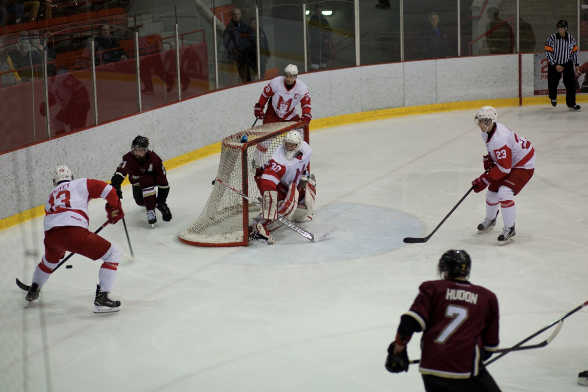 McGill looks to clear the puck out of their own zone. Photos by Marie-Pierre Savard.