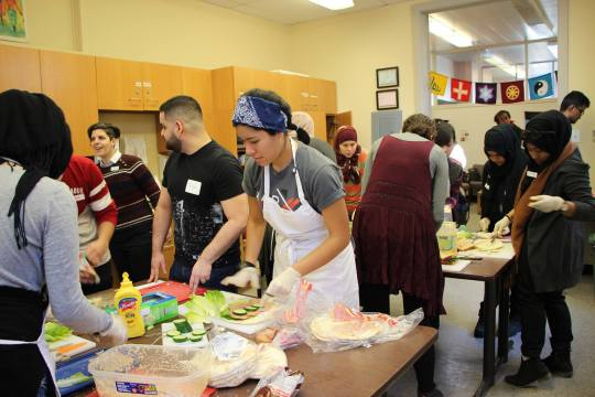 Concordia community members feed the homeless for Multi-Faith Day of Action. Photo by Mishkat Hafiz