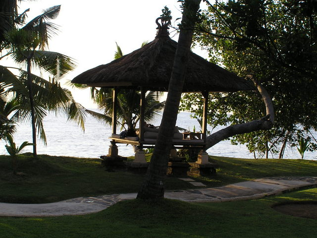 Daybed among the manicured grounds of the Puri Bagus Resort, Lovina