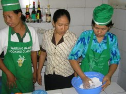Adi working to get the consistency of the coconut and rice flour mixture correct