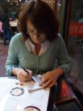 Maria drawing pictures in order to find out which animals were on the menu at our favourite Beijing eatery