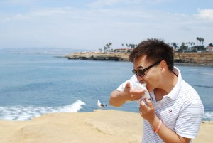 Me eating my first cronut at Sunset Cliffs, in San Diego