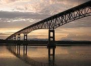 Steel girders under-deck truss bridge