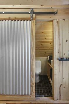 Corrugated steel sheet door
