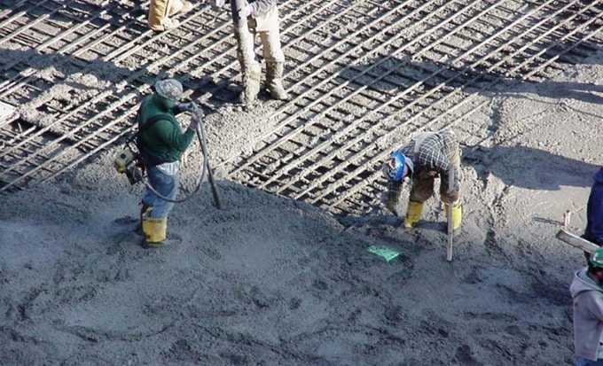 Shrinkage Compensating Concrete Construction for Slabs-on-Ground