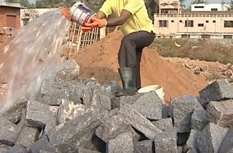 Wetting stones for stone masonry footing construction