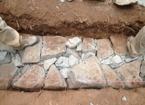 Small sized stones are placed to fill voids