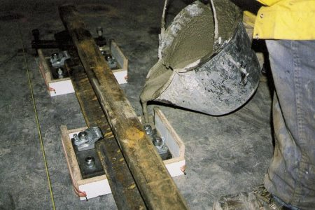 Use of expansive cement mortar in grouting of anchor bolts.
