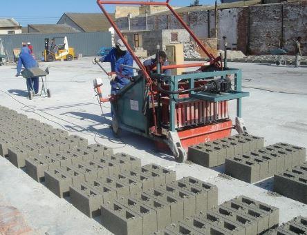 Machine molding of sandcrete block