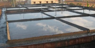 Curing concrete slab by ponding