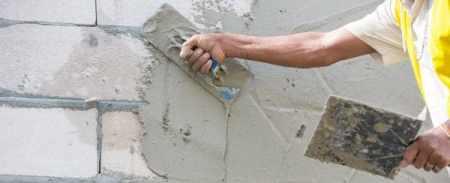 Applying of base coat of plastering for brick masonry