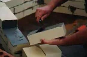 Laying Bricks Using Refractory Mortar