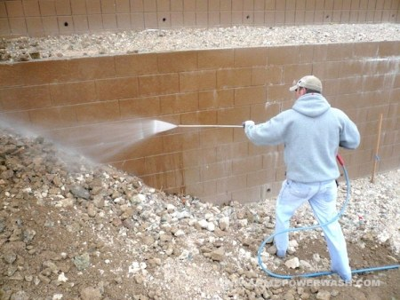 Removal of efflorescence using pressurised water.