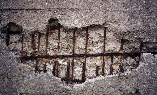 Spalling of Concrete Due to Corrosion of Steel Bars in Aggressive Environment