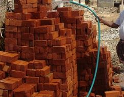 Wetting Bricks with Water Before Laying