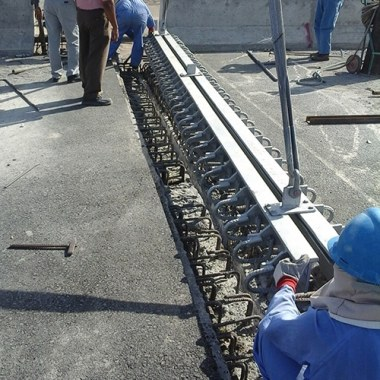 Placing of strip seal expansion joint