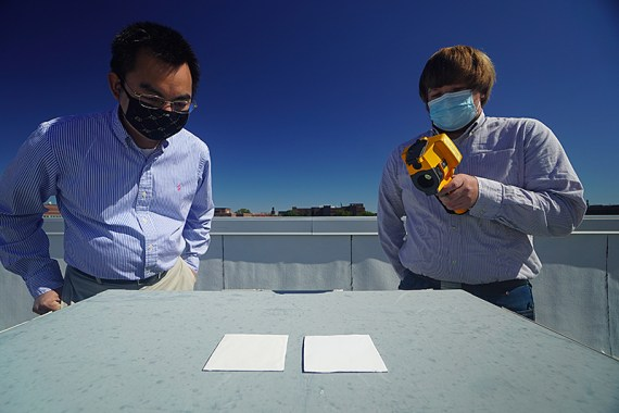 Researchers compare the cooling performance of white paint samples using an infrared camera