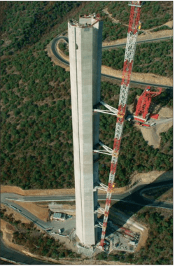Erection of Millau Viaduct piers with external self-climbing forms and classical internal shutters moved by the tower crane