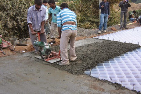 Laying of Cell filled Concrete Pavement