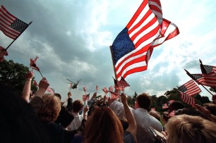 Staff members wave American flags as they gather on the South Lawn of the White House Friday, Sept. 21, 2001, as President George W. Bush and Mrs. Laura Bush depart for Camp David aboard Marine One. Photo by Paul Morse, Courtesy of the George W. Bush Presidential Library