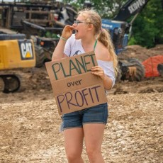 Hood protesting pipeline