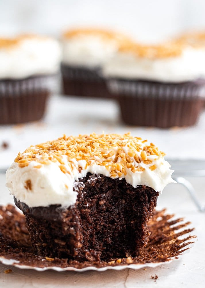 chocolate coconut cupcake with bite out of it