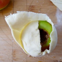 wrapping the dough around apple