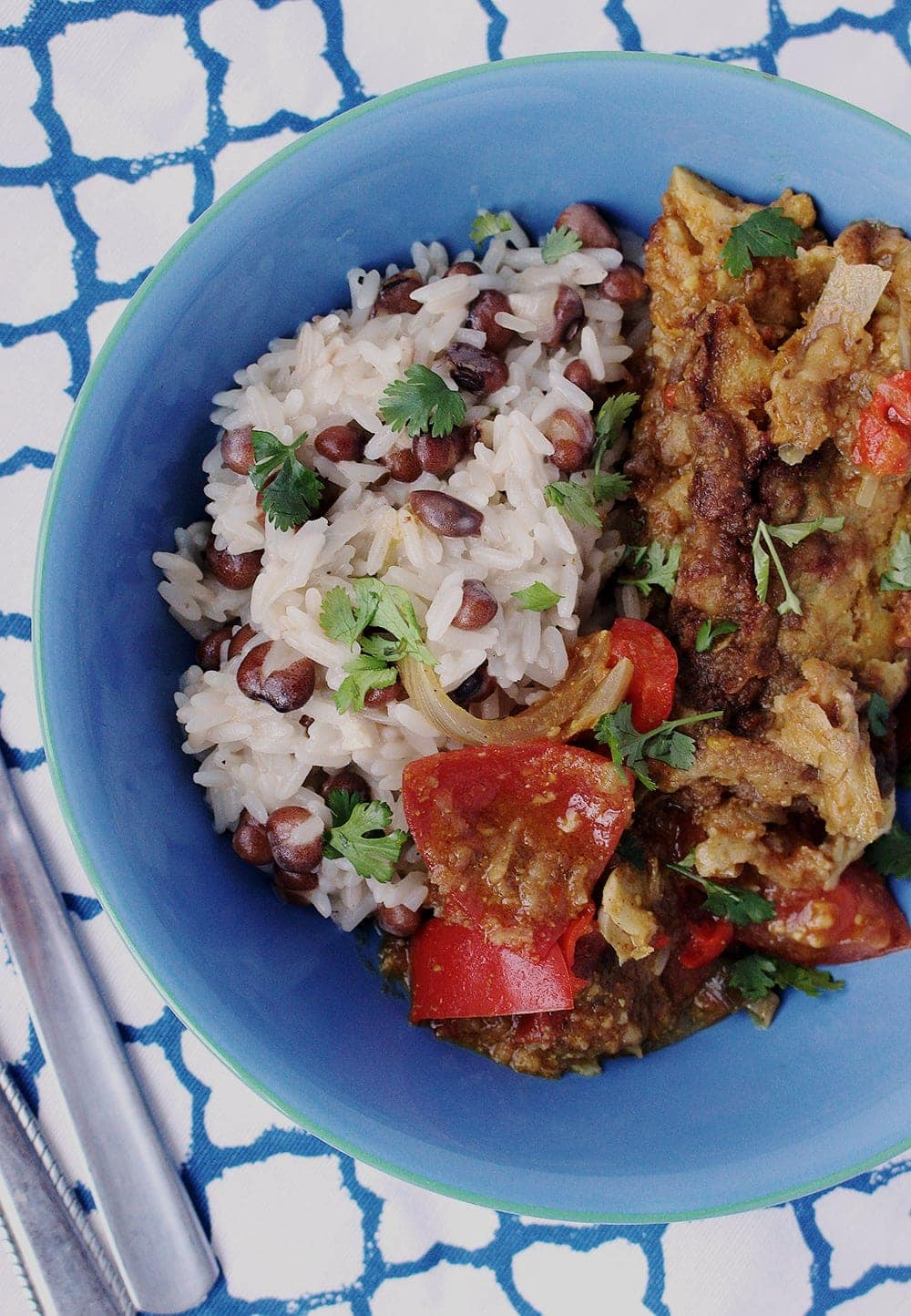 This Jamaican fish curry is bursting with spicy flavour and is perfect paired with creamy, coconutty rice and peas and a sprinkling of fresh coriander.