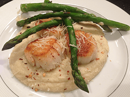 Seared scallops with steamed cauliflower