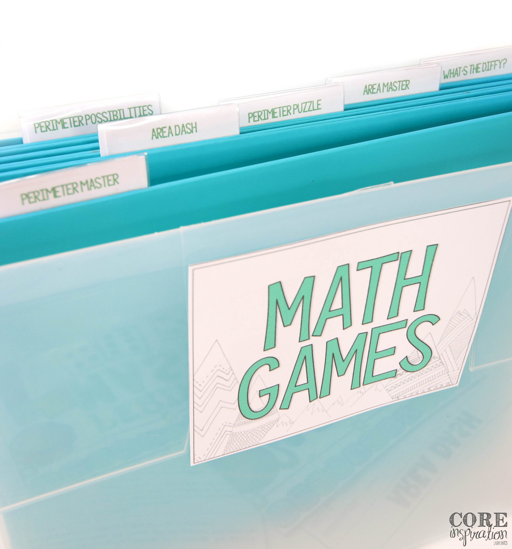An aqua smaller file bin is a perfect place to store math games for one unit if you prefer not to store them in bins or binders. All the games for Core Inspiration's area and perimeter math game bundle are shown on labels in this photo.