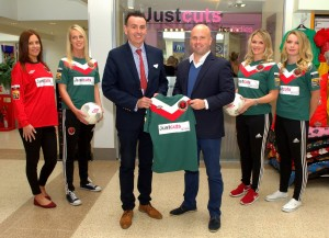 Jeff Devine of Justcuts/  Jeff Devine Hair Group  with Niall O'Regan, CCWFC Manager at the Justcuts sponsorship launch at his premises in Wilton S.C.   Included are Justcuts Asst Manager Kayleigh O'Donovan (in red)  and Cork City Womens FC players Barbara O'Connell, Stacey Paul and Saoirse Noonan. Picture : Doug Minihane
