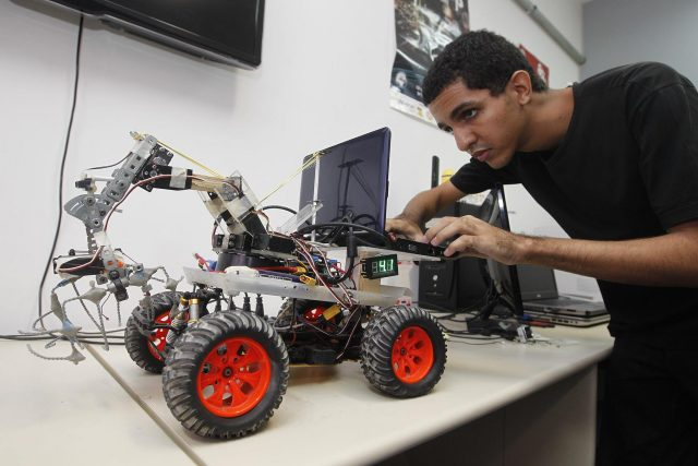Competitor adjusting his robot