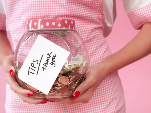 It is common that some workers show their tip jar to ask for tipping.