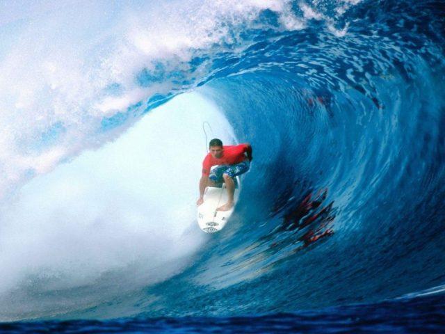Surfing big wave down