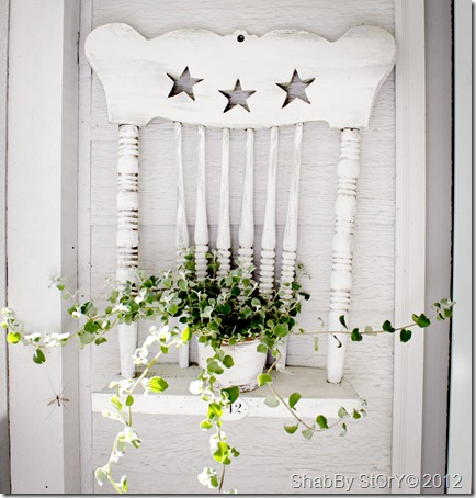 Love this outdoor thrift store DIY project - remove the legs from an old wooden chair and attach to the wall for a decorative plant stand