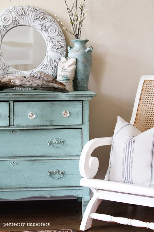 This dresser is decorated for the season! I love the weathered paint look on this thrift store dresser
