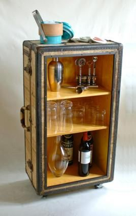 Another vintage suitcase thrift store DIY project - this one makes a classic alcohol cabinet and makeshift bar