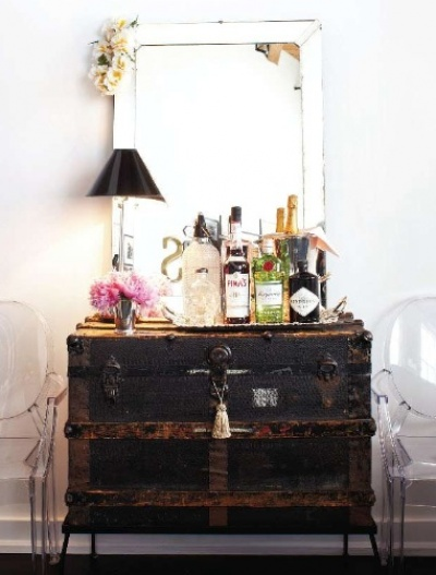 This old steamer trunk was upgraded into a mini bar - love the vintage industrial look!