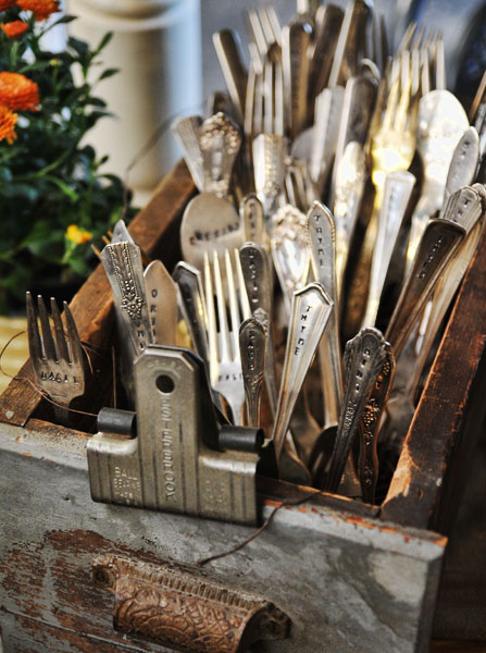 This industrial file cabinet drawer is now a great spot to stick some old sterling silver cutlery for a stunning centerpiece